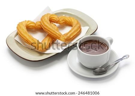 heart shape churros and hot chocolate on white background, spanish breakfast - stock photo