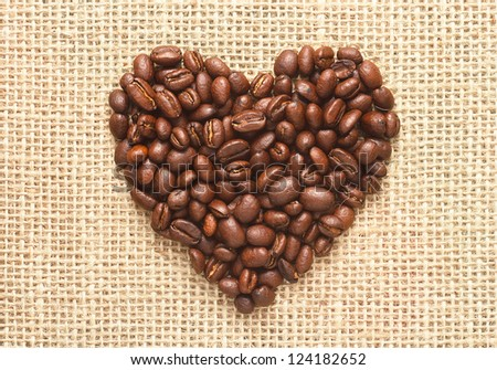 heart shape coffee beans on sacking background