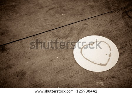 Heart shape coffee stain on wooden table valentine background