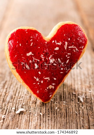 Heart shape cookie on the wooden table - stock photo