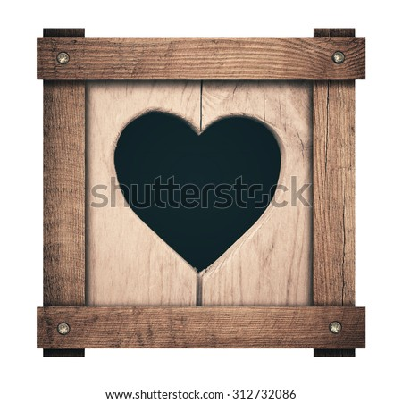 Heart shape cut on wooden planks and screwed frame - stock photo