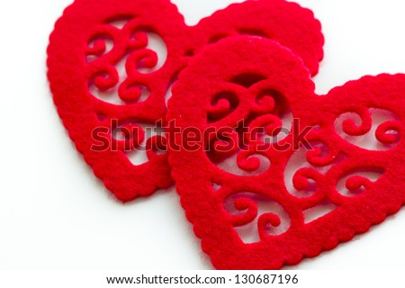 Heart shape doilies on white background.