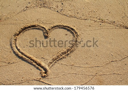 Heart shape drawn on beach sand