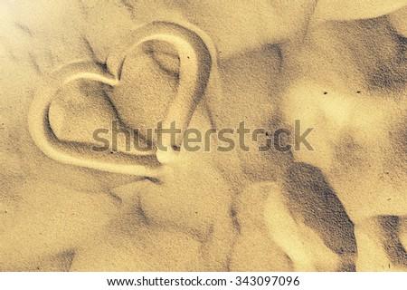 Heart shape drawn on sand. Summer & beach background - stock photo