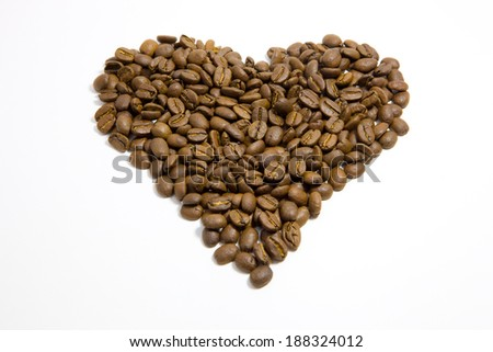 Heart shape formed of fresh roasted coffee beans symbolizing a love of espresso or cappuccino coffee or as a romantic gesture for a loved one on Valentines, wedding or anniversary, isolated on white - stock photo