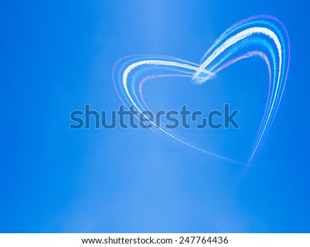 Heart shape from smoke in the sky - stock photo