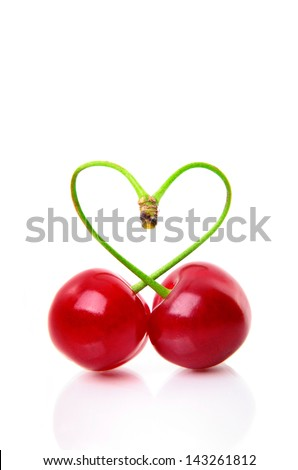 Heart shape from two cherries over white, with space for your text - stock photo