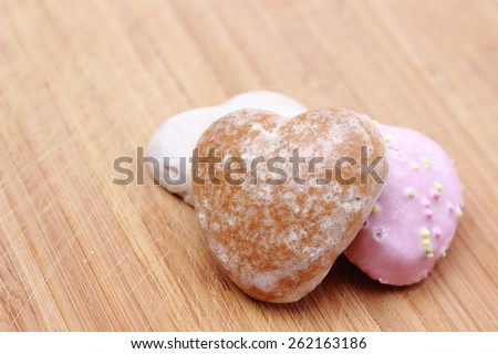 heart shape gingerbread Cookie over wooden background - stock photo