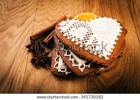 heart shape gingerbread cookies  with spices on rustic table