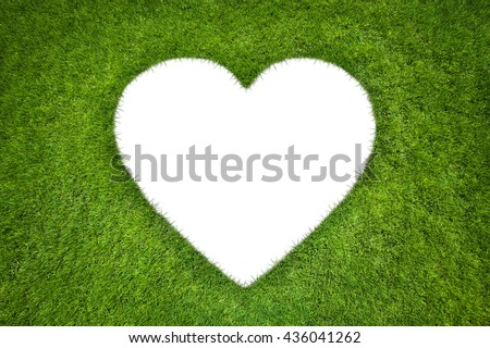Heart shape in green grass background - stock photo