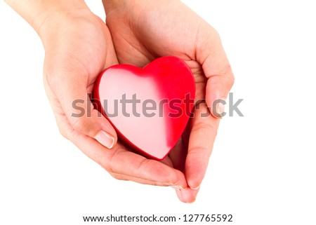 Heart shape in hands as love symbol
