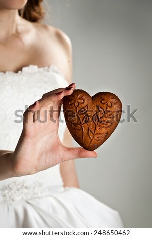 heart shape in the hands of a young woman - stock photo