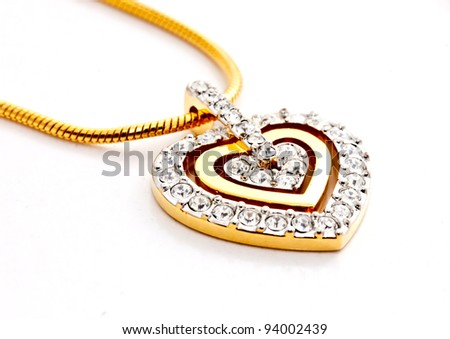 heart shape locket decorated with diamonds on white background - stock photo