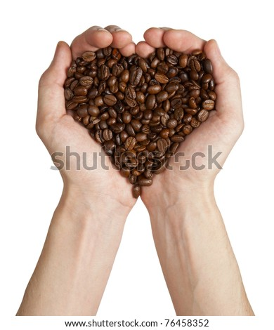 Heart shape made from coffee beans in hands, isolated on white background - stock photo
