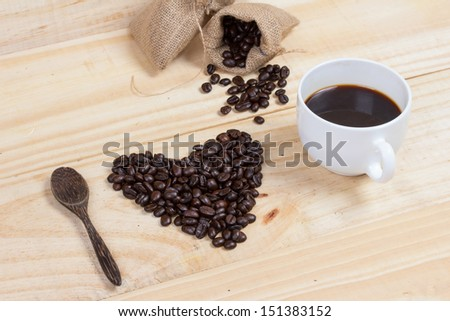 heart shape made from coffee beans spelling i love coffee - stock photo
