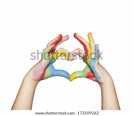 Heart shape made from kids painted hands - stock photo