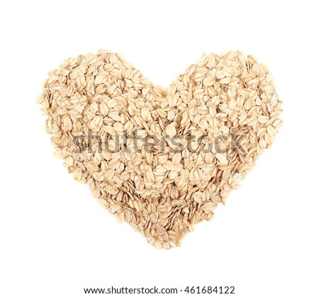 Heart shape made of oatmeal flakes, composition isolated over the white background