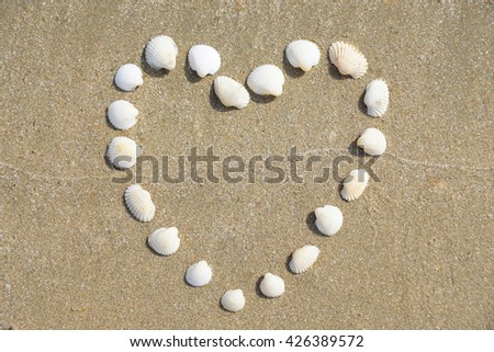 Heart Shape made of shells on the sandy beach