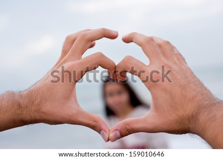 heart shape made of two   palms - stock photo