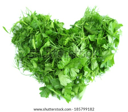 Heart shape of chopped herbs, isolated on white - stock photo