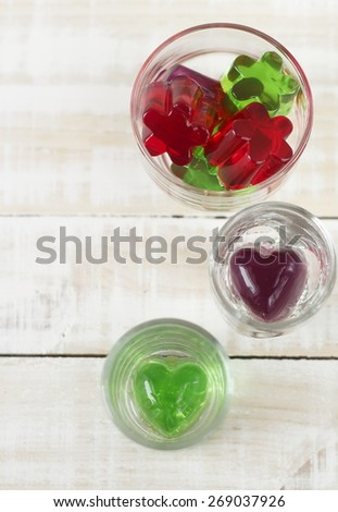 heart shape of colorful jelly in glass on white background - stock photo