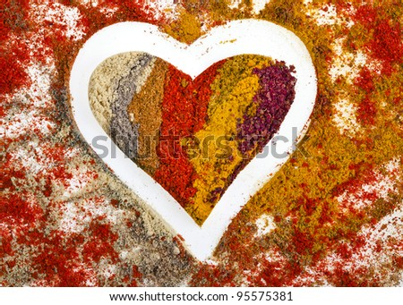 Heart Shape of Colorful Spice Powder Mix Surface
