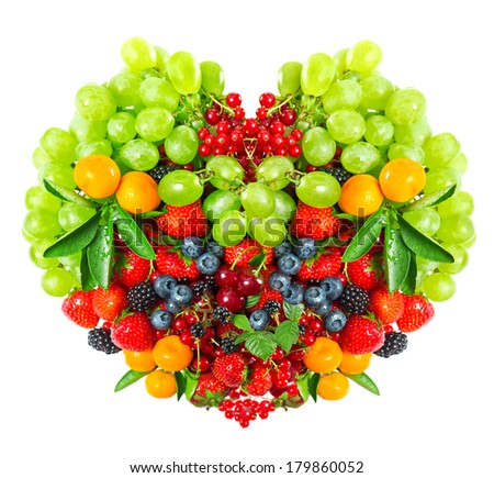 heart shape of mixed berries and fruits isolated on white. food background - stock photo