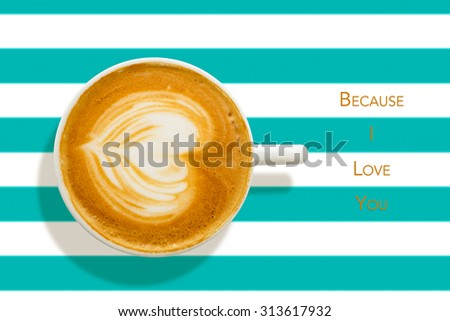 Heart shape on a caffe latte shot from directly above with horizontal teal colored pinstripes in the background with text on the side, because I love you. - stock photo
