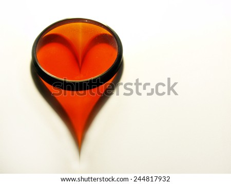 Heart shape on a white paper sheet with space for a text - stock photo