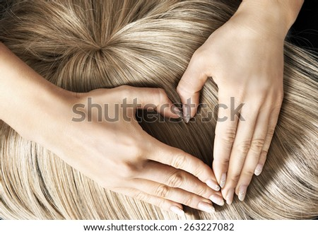 Heart shape on blond hair - stock photo