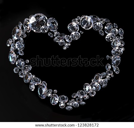 heart shape scattered brilliant diamonds on black background - stock photo
