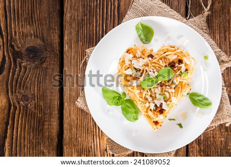 Heart Shape Spaghetti with fresh homemade Tomato Pesto - stock photo