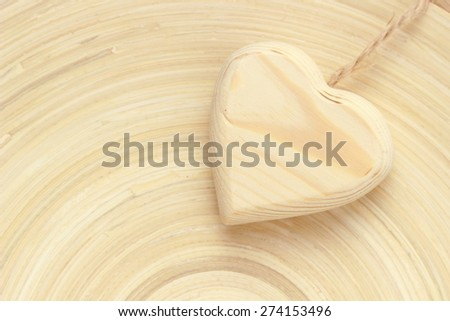 Heart shape symbol over texture of bamboo plate