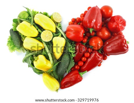 Heart shape vegetable composition isolated on white - stock photo