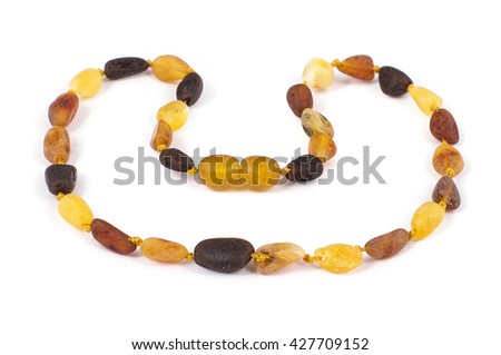 Heart shaped amber necklace isolated on the white background - stock photo