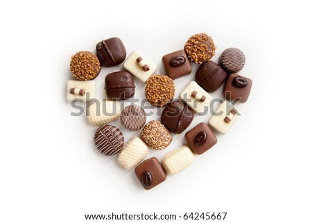 heart shaped assortment of delicious chocolate praline sweets - stock photo