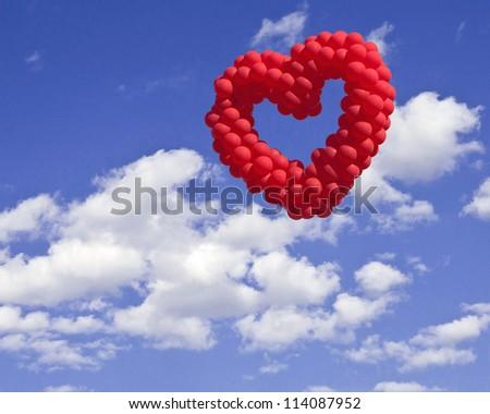 heart-shaped baloon in the sky, the symbols of love - stock photo