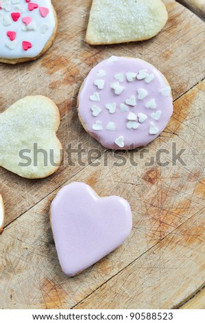 Heart-shaped biscuits on a wooden board. - stock photo