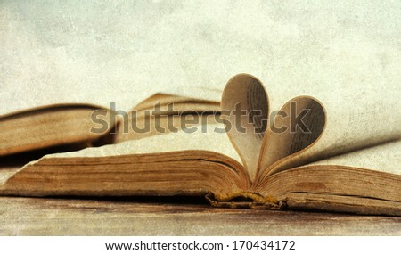 Heart shaped book pages - stock photo