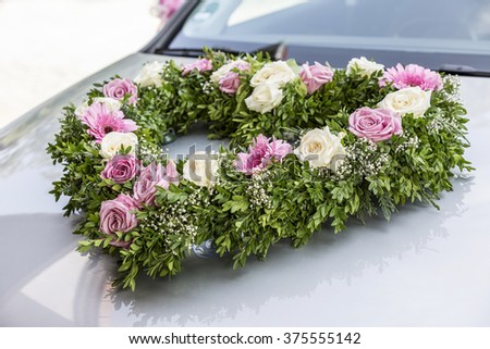 Heart-shaped bouquet for bridal car with white and pink roses - stock photo