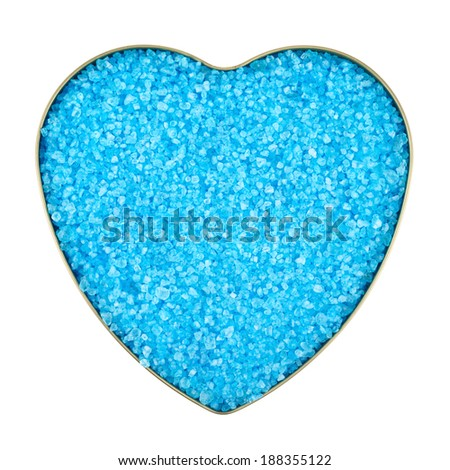 Heart shaped box filled with blue colored salt crystals, isolated over the white background - stock photo