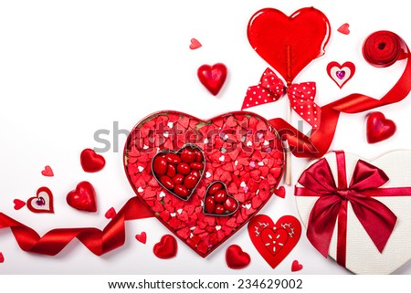 Heart shaped box with Valentine's Day candies on the white background - stock photo