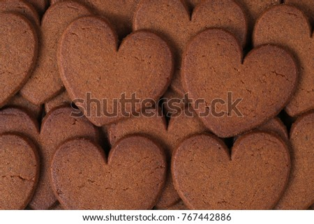 Heart shaped brown cookies background