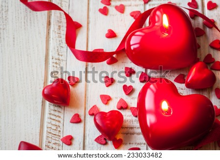 Heart shaped candles and sweet candy for Valentine's day - stock photo