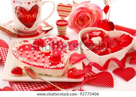 heart shaped cheese cake with jelly  on the table with valentine`s decoration - stock photo