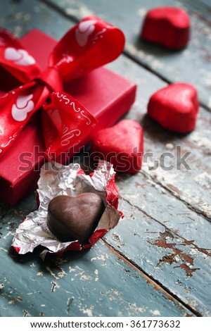 Heart shaped chocolate truffles with gift/ valentines day background  - stock photo