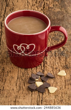 heart shaped chocolates and coffee in a mug decorated with hearts