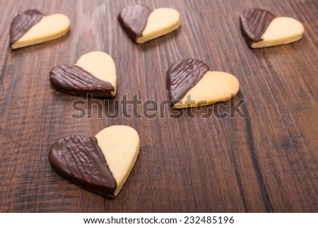 Heart shaped christmas cookies with chocolate - stock photo
