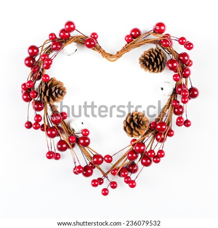 Heart shaped Christmas decoration with pine cones isolated on white background with copy space - stock photo