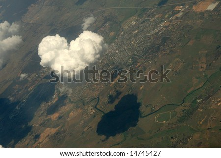 Heart shaped clouds on sky - stock photo